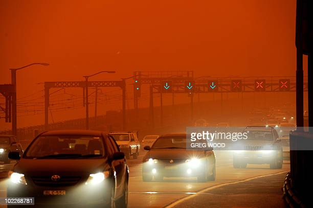 Traffic makes its way off the Sydney Harbour Bridge on September 23 2009 as Australia's biggest city is shrouded in an eerie blanket of red dust...