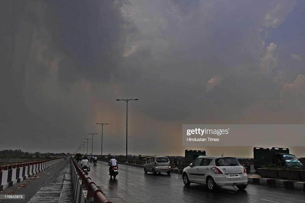 Traffic move in clouded weather before the pre monsoon rain on June 14, 2013 in New Delhi, India. The city received 11.6 mm rainfall and the humidity oscillated between 47 and 91 percent.