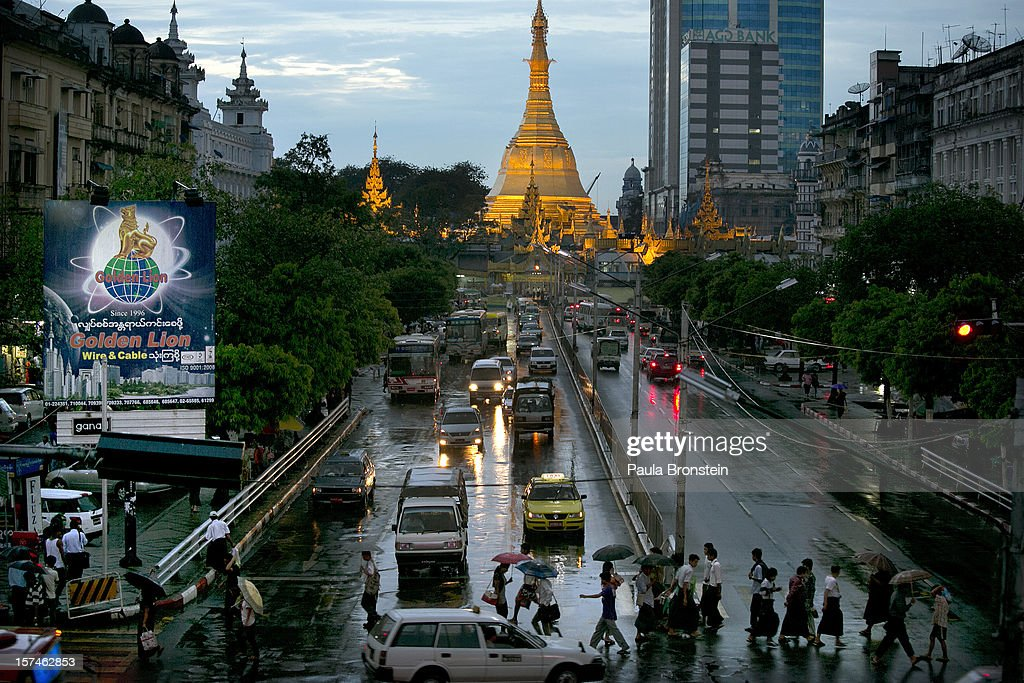 Traffic moves along a busy downtown street November 30 2012 in Yangon Myanmar Business is booming in this newly opened Southeast Asian country Import...
