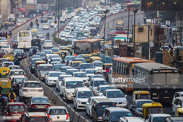 Traffic moves along a highway during evening rush hour in Delhi India on Monday Jan 11 2016 In a city where motorists routinely run red lights and...