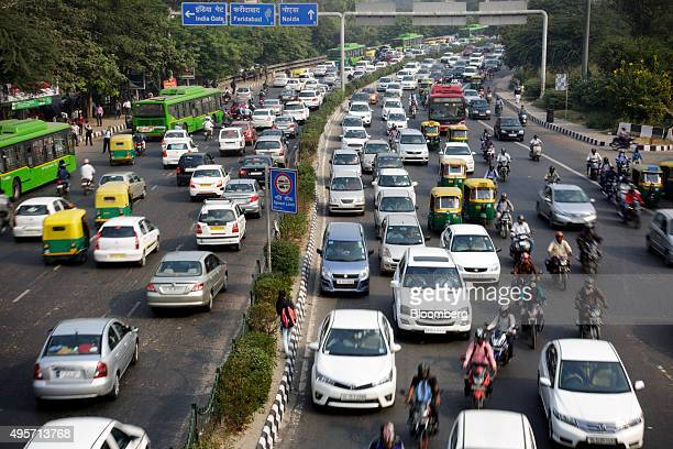 Traffic moves along a highway during morning rush hour in Delhi India on Oct 29 2015 India in October was the last major nation to submit its...