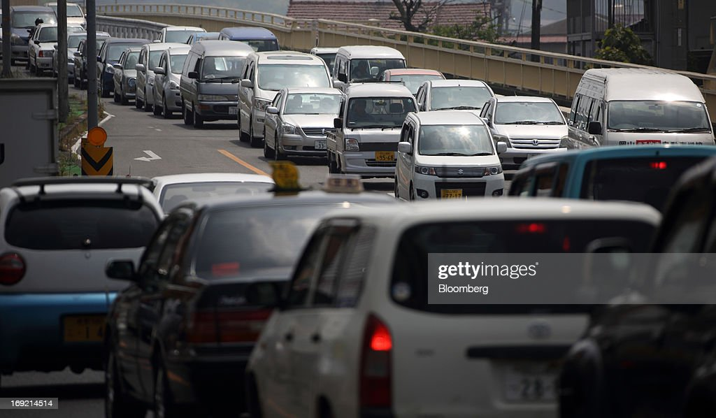 Traffic moves along a road in Okayama, Japan, on Tuesday, May 21, 2013. The Bank of Japan, forecast to maintain plans for expanded monetary easing at a meeting ending on May 22, is targeting 2 percent inflation in two years after more than 10 years of entrenched deflation. Photographer: Tomohiro Ohsumi/Bloomberg via Getty Images