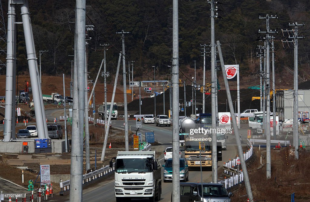 Traffic moves along a road past utility poles in Rikuzentakata, Iwate Prefecture, Japan, on Thursday, March 6, 2014. Reconstruction of Tohoku, the northern Japan region devastated by the 2011 tsunami, continues as the third anniversary of the disaster approaches. Photographer: Tomohiro Ohsumi/Bloomberg via Getty Images