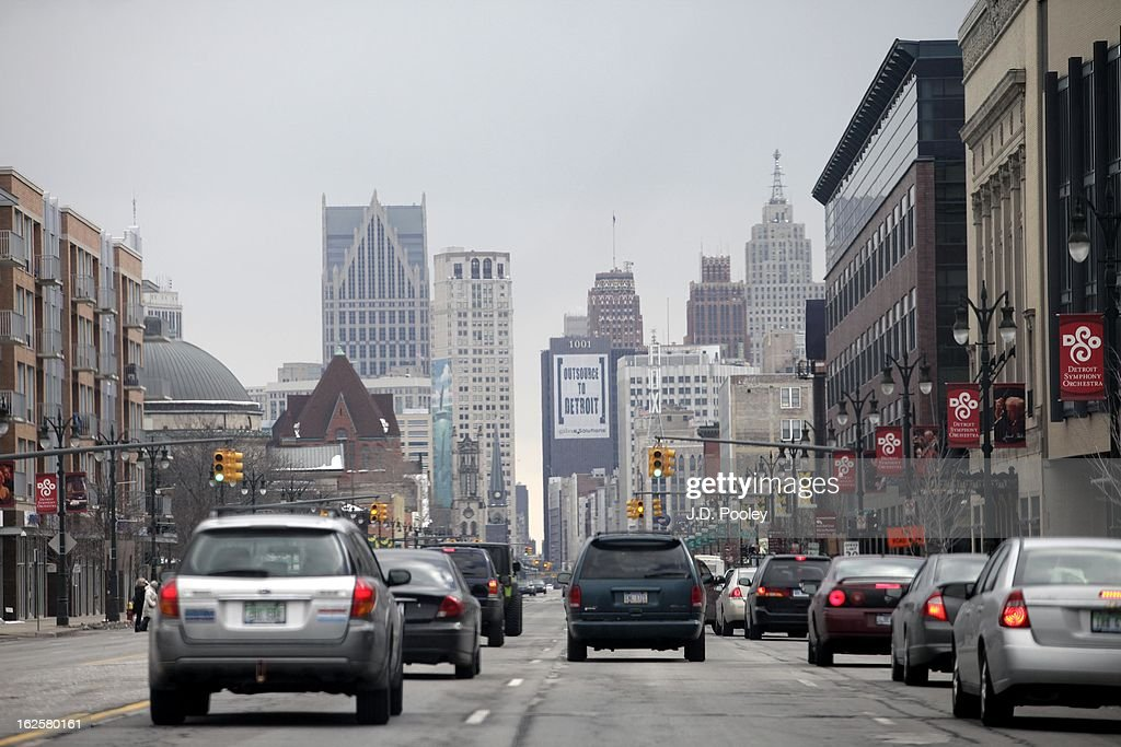 Traffic moves along a street February 24, 2013 in Detroit, Michigan. The city of Detroit has faced serious economic challenges in the past decade, with a shrinking population and tax base while trying to maintain essential services. A financial review team issued a finding on February 19 identifying the city as being under a 'financial emergency.' Michigan Gov. Rick Snyder has 30 days from the report's issuance to officially declare a financial emergency, which could result in the governor appointing an emergency financial manager to oversee Detroit's municipal government.