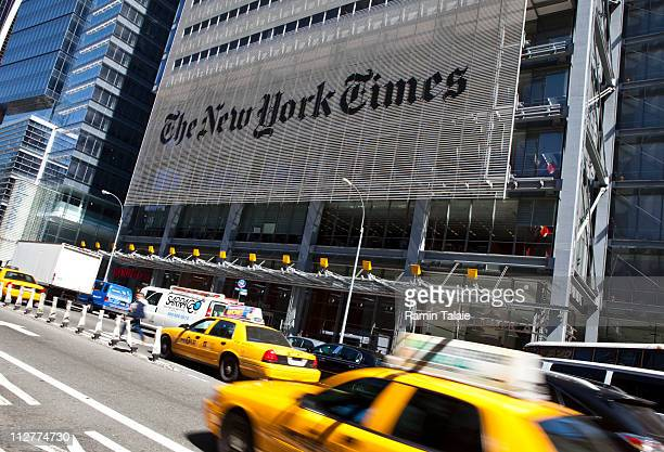 Traffic moves along by The New York Times headquarters building April 21 2011 in New York City The New York Times profits fell 58 percent in the...