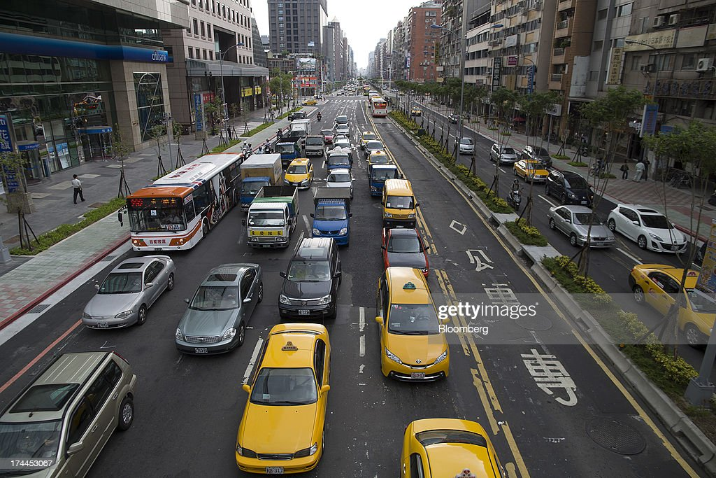 Traffic moves along Hsin Yi Road in Taipei, Taiwan, on Wednesday, July 24, 2013. Taiwan President Ma Ying-jeou ruled out driving down the Taiwan dollar to boost exports following the currencys rally against the yen and said the government still aims for growth of at least 2 percent this year. Photographer: Jerome Favre/Bloomberg via Getty Images