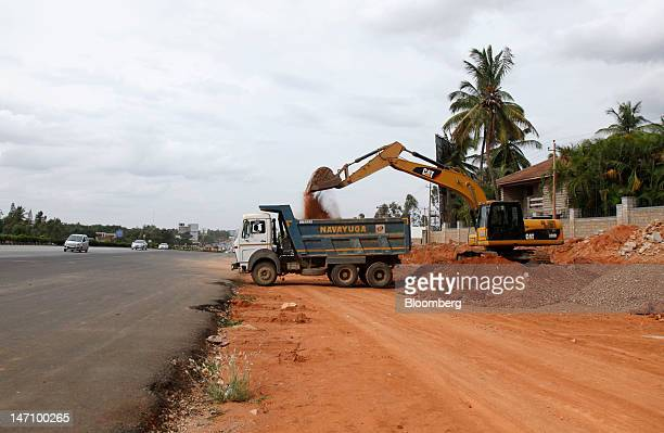 Traffic moves along National Highway 7 as road construction takes place in Bangalore India on Friday June 22 2012 The city's traffic jams make it the...