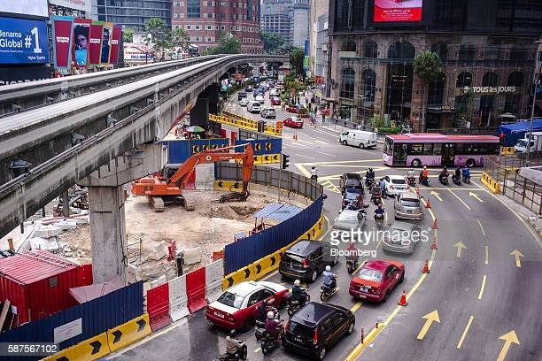 Traffic moves alongside a construction site in downtown in Kuala Lumpur Malaysia on Friday Aug 5 2016 Malaysia's secondquarter gross domestic product...