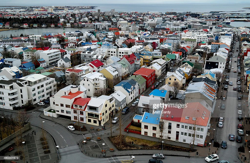 Traffic moves around the buildings in the Icelandic capital is seen from the top of the Hallgrimskirkja tower on April 7 2014 in Reykjavik Iceland...