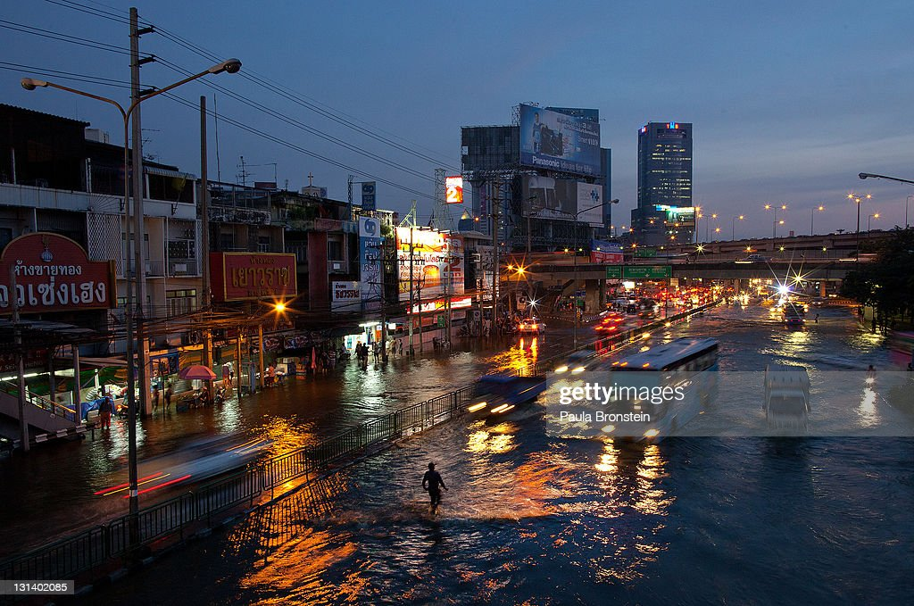 Traffic moves as flood waters take over the streets moving to a the Lat Phrao area which is a major shopping and business district November 4, 2011 in Bangkok, Thailand. Over seven major industrial parks in Bangkok and, thousands of factories have been closed in the central Thai province of Ayutthaya and Nonthaburi with millions of tons of rice damaged. Thailand is experiencing the worst flooding in over 50 years which has affected more than nine million people. Over 400 people have died in flood-related incidents since late July according to the Department of Disaster Prevention and Mitigation.