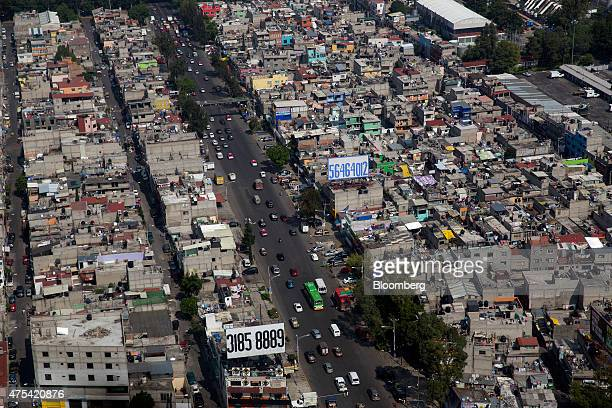 Traffic moves down a street in this aerial photo taken during a Red Wings Co TuriSky helicopter tour of Mexico City Mexico on Friday May 22 2015 Red...