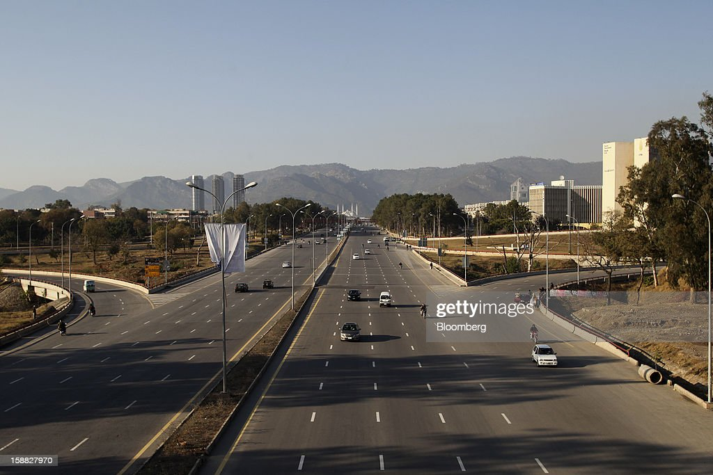 Traffic moves down Faisal Avenue in Islamabad, Pakistan, on Sunday, Dec. 30, 2012. Pakistan's economy will probably expand 3.5 percent in the 12 months through June, the International Monetary Fund forecast Nov. 29, less than the 4.3 percent predicted by the government. Photographer: Asad Zaidi/Bloomberg via Getty Images