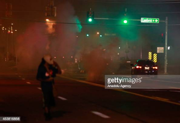Traffic moves hardly due to the smoke during a protest on August 18 2014 for Michael Brown who was killed by a police officer on August 9 in Ferguson...
