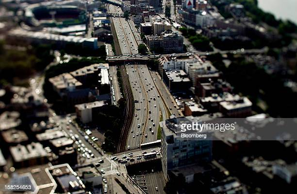 'BEST PHOTOS OF 2012' Traffic moves on a highway in this photo taken with a tilt shift lens in Boston Massachusetts US on Tuesday Aug 7 2012 Boston a...