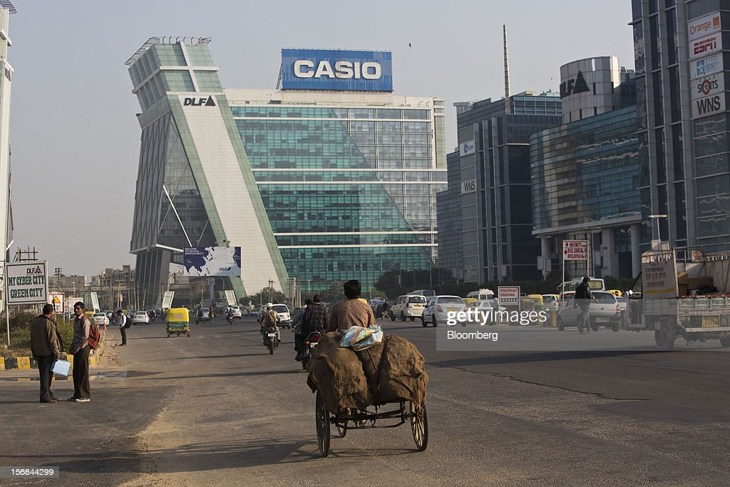Traffic moves on a road in Gurgaon, India, on Wednesday, Nov. 21, 2012. Indian Prime Minister Manmohan Singh aims to spur spending on infrastructure to revive a faltering economy and tackle bottlenecks contributing to one of Asia's highest inflation rates. Photographer: Brent Lewin/Bloomberg via Getty Images