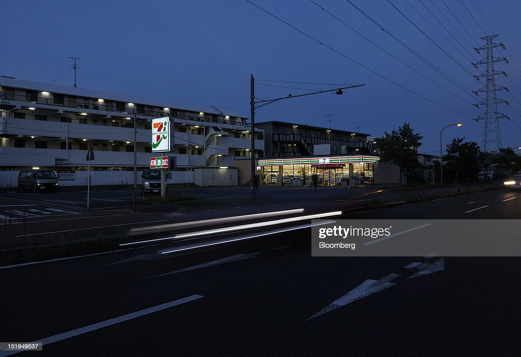 Traffic moves past a 7-Eleven convenience store, operated by Seven & I Holdings Co., in Yokohama City, Kanagawa Prefecture, Japan, on Tuesday, Sept. 11, 2012. Sales at Japan's convenience stores declined 3.3 percent in July from a year ago on a same-store basis, according to the Japan Franchise Association. Photographer: Akio Kon/Bloomberg via Getty Images