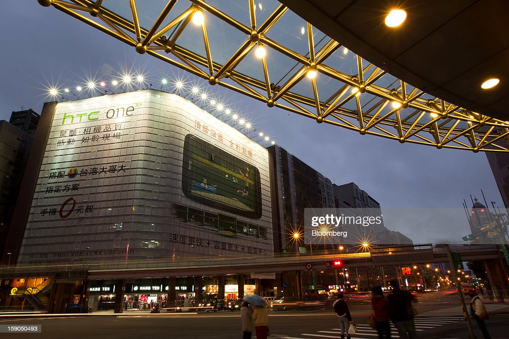 Traffic moves past a billboard advertisement for HTC Corp.'s One X+ smartphone in Taipei, Taiwan, on Sunday, Jan. 6, 2013. HTC is scheduled to release fourth-quarter earnings on Jan. 7. Photographer: Maurice Tsai/Bloomberg via Getty Images
