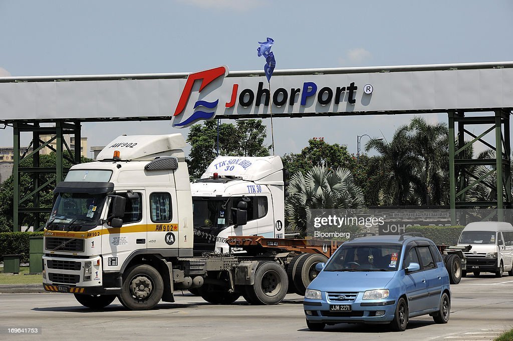 Traffic moves past Johor Port in Pasir Gudang, Johor, Malaysia, on Monday, May 13, 2013. At a time when copper stockpiles are rising to the highest in a decade, manufacturers are paying the biggest premiums for the metal in as much as seven years as financing deals lock up supply and extend lines at warehouses. Photographer: Munshi Ahmed/Bloomberg via Getty Images