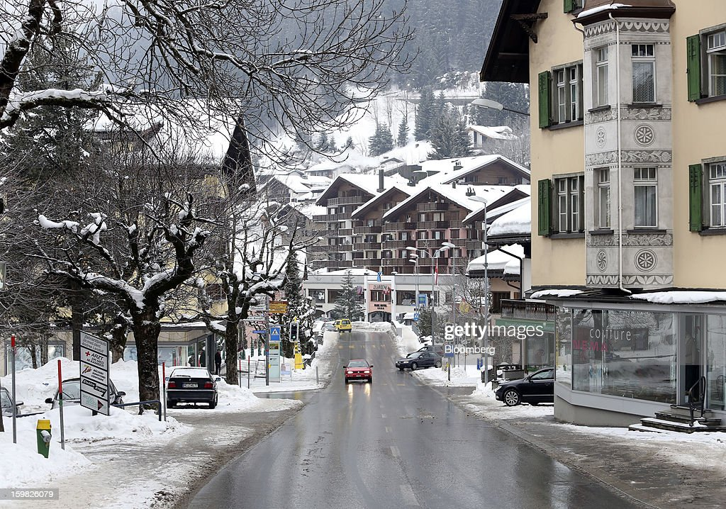 Traffic moves past property lining the main street in Klosters, Switzerland, on Monday, Jan. 21, 2013. This week the business elite gathers in the Swiss Alps for the 43rd annual meeting of the World Economic Forum in Davos, the five day event runs from Jan. 23-27. Photographer: Chris Ratcliffe/Bloomberg via Getty Images