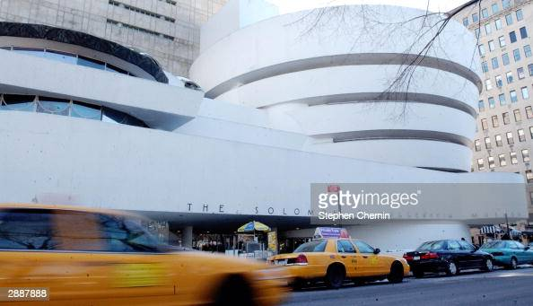 Traffic moves past the front of the Solomon R Guggenheim Museum January 21 2004 in New York City Designed by architect Frank Lloyd Wright the...