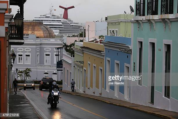 Traffic moves through a street in Old San Juan as the island's residents deal with the government's $72 billion debt on July 1 2015 in San Juan...