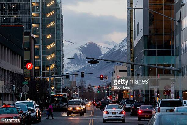 Traffic moves through downtown Anchorage Alaska US on Wednesday Nov 5 2014 Voters in Anchorage on Nov 4 approved a referendum that voids a...