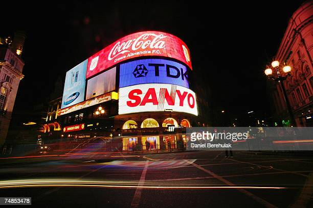 Traffic moves through Piccadilly Circus as the landmark advertising lights are turned bback on after the Capital 958 Light Out London Campaign on...