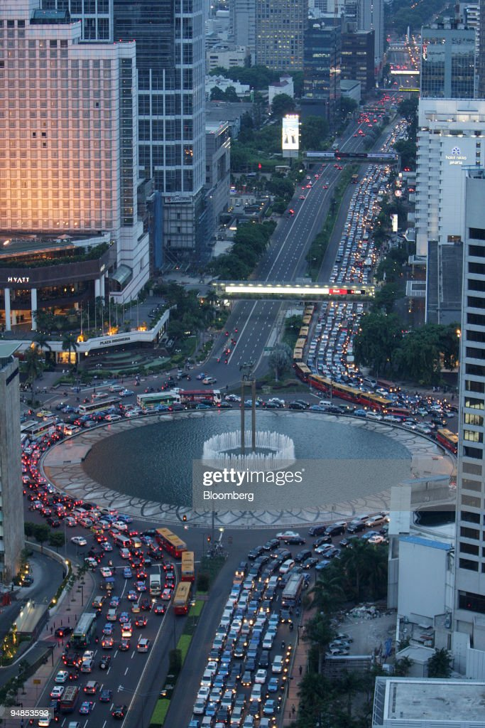 Traffic moves through the buildings in downtown Jakarta Indonesia on Wednesday Nov 12 2008 Indonesia's gross domestic product report will be released...