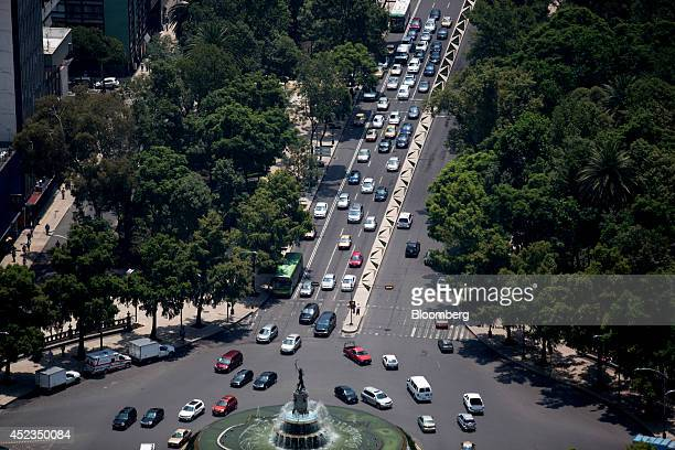 Traffic moves through the Diana Cazadora roundabout on Reforma Avenue as seen from BBVA Bancomer's Mexico headquarters building under construction in...