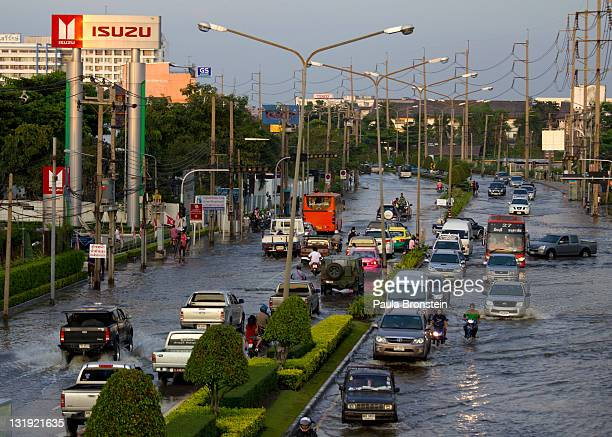 Traffic moves through water logged streets at the Bangchan Industrial Estate area on the outskirts of the capitol city November 8 2011 in Bangkok...