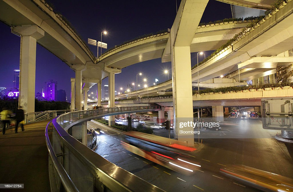 Traffic moves under elevated roads at night in Shanghai, China, on Wednesday, Jan. 30, 2013. China's economic growth accelerated for the first time in two years as government efforts to revive demand drove a rebound in industrial output, retail sales and the housing market.Photographer: Tomohiro Ohsumi/Bloomberg via Getty Images