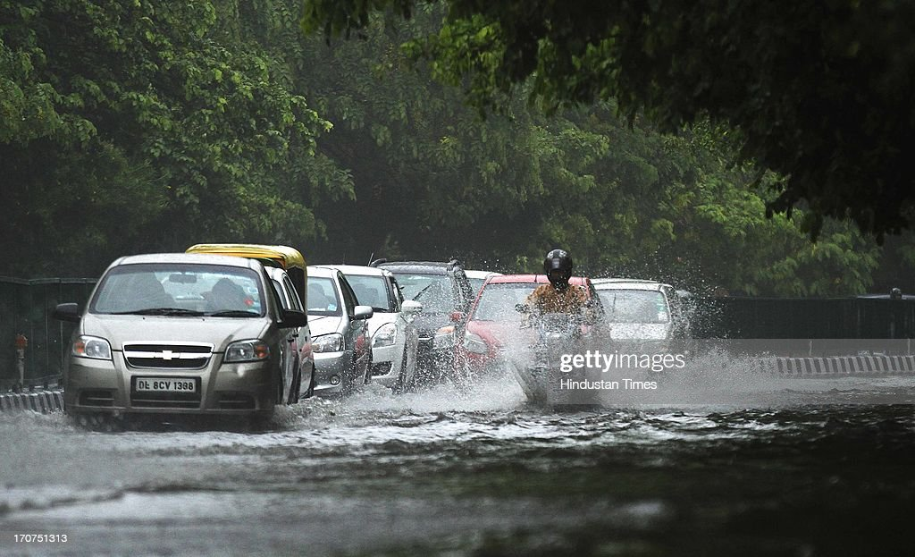 Traffic moving in water logged road due to the heavy rain at Siri fort road on June 17, 2013 in New Delhi, India. Delhi had its first heavy rainfall. The Delhi government began evacuating people from low-lying areas along the banks of the Yamuna river after 8.06 lac cusecs of water was released from Hathnikund barrage in Haryana.