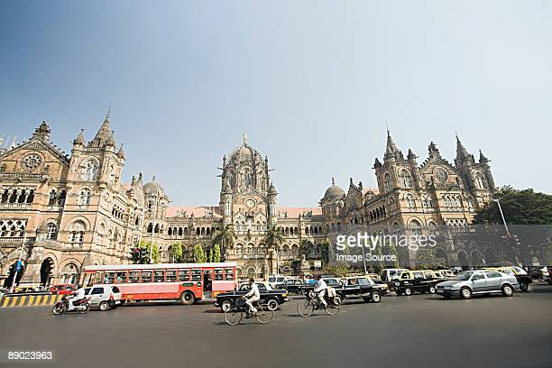 Traffic moving past an ornate church