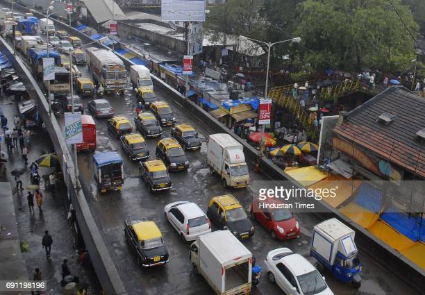 Traffic moving slow as potholes are seen on Dadar West Railway Station Flyover on Tulsi Pipe Road on Saturday