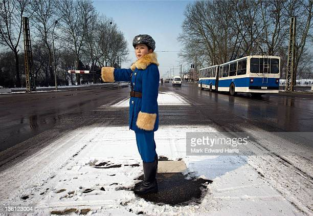 A traffic officer directing traffic on the streets of the North Korean capital on February 26 2008 in Pyongyang North Korea