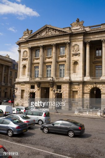 Traffic on a road in front of a building, Paris, France : Stock Photo