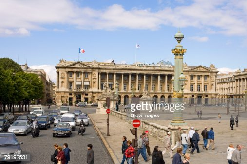 Traffic on a road in front of a hotel, Hotel Crillon, Paris, France : Stock Photo