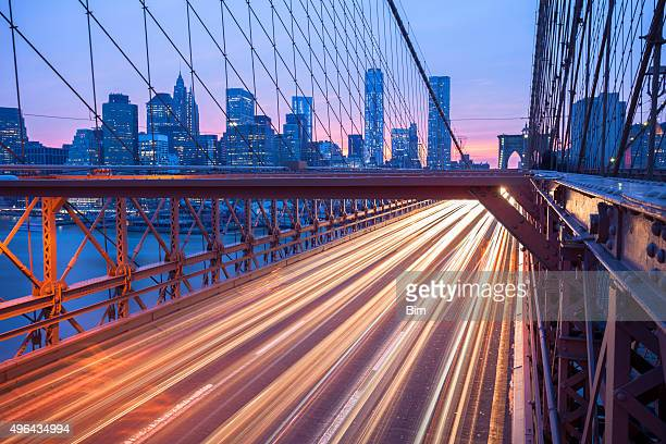 Traffic on Brooklyn Bridge at Dusk, Manhattan Skyline, New York
