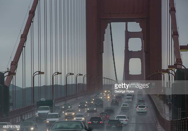 Traffic on Highway 101 slows down in a heavy rainstorm as it crosses the Golden Gate Bridge on April 1 in San Francisco California San Francisco...