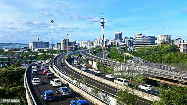 Traffic On Highway And Cityscape