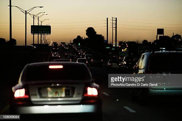 Traffic on highway at dusk