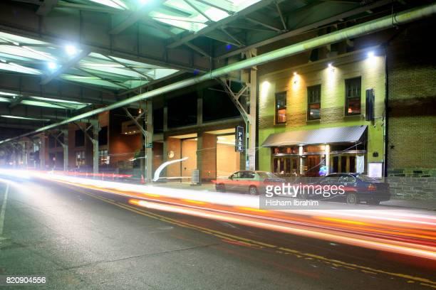 Traffic on K Street in Georgetown at night, Washington DC, USA