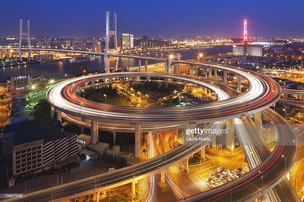 Traffic on roundabout leading to Nanpu bridge dusk