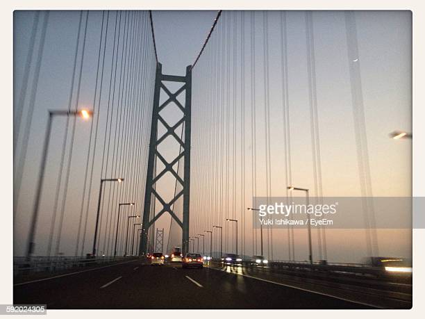 Traffic On Suspension Bridge During Sunset