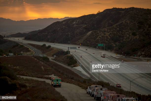 Traffic on the 210 freeway is allowed to resume for the first time since the start of the La Tuna Fire as light rain showers pass over the burn areas...
