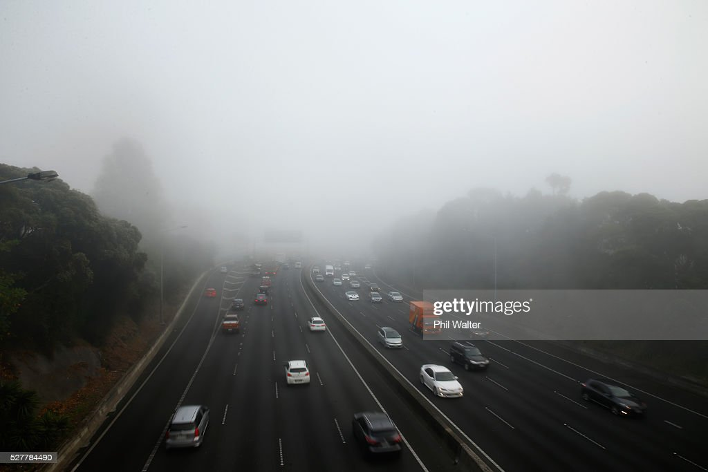 Traffic on the motorways is backed up under a blanket of fog over Auckland City on May 4, 2016 in Auckland, New Zealand. The morning fog disrupted flights and ferry services in the city.