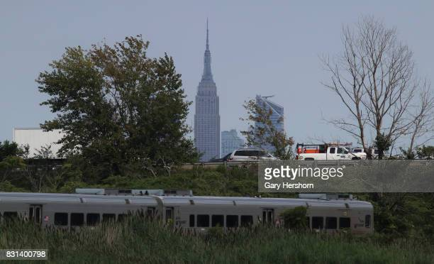 Traffic on the New Jersey Turnpike drives past the skyline of midtown Manhattan and the Empire State Building in New York City along with a NJ...