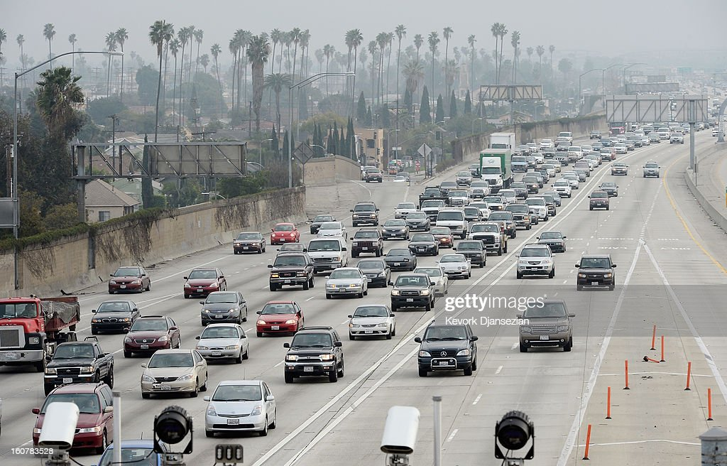 Traffic on the northbound and southbound lanes of the 110 Harbor Freeway starts to stack up during rush hour traffic on February 5, 2013 in Los Angeles, United States. According to a report, traffic congestion was the second-worst in the country in the greater Los Angeles area. An average commuter spent 61 hours delayed in traffic during 2011. The cost of the wasted time and gas is about $1,300 per commuter according to a report.