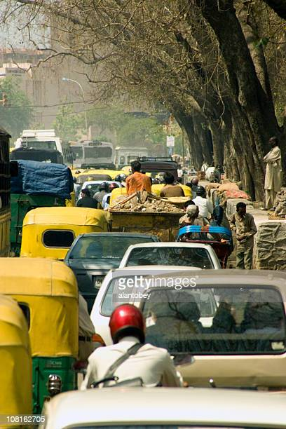 Traffic on Tree-Lined Road in New Delhi, India