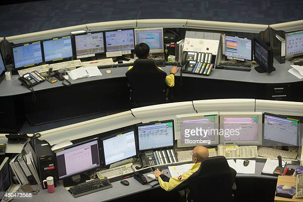 Traffic operators work at computer terminals inside the MTR Corp operations control center at Tsing Yi station in Hong Kong China on Thursday June 12...